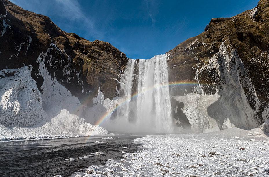 Neujahr & Polarlichter: Der Wasserfall Skógafoss