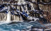 Island Rundreisen Hraunfossar im Winter
